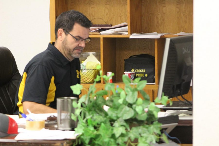 Mr. Johanson works at his desk during the school day. Frequently, students will see him in the hallways and visiting classrooms throughout the day.