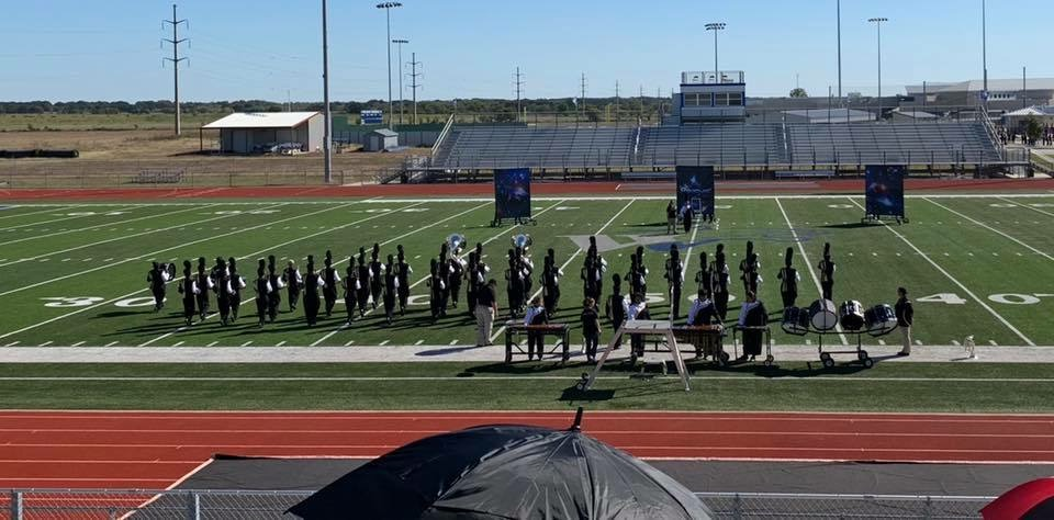 The Cougar Marching Band performs at Area competition in Whitney.