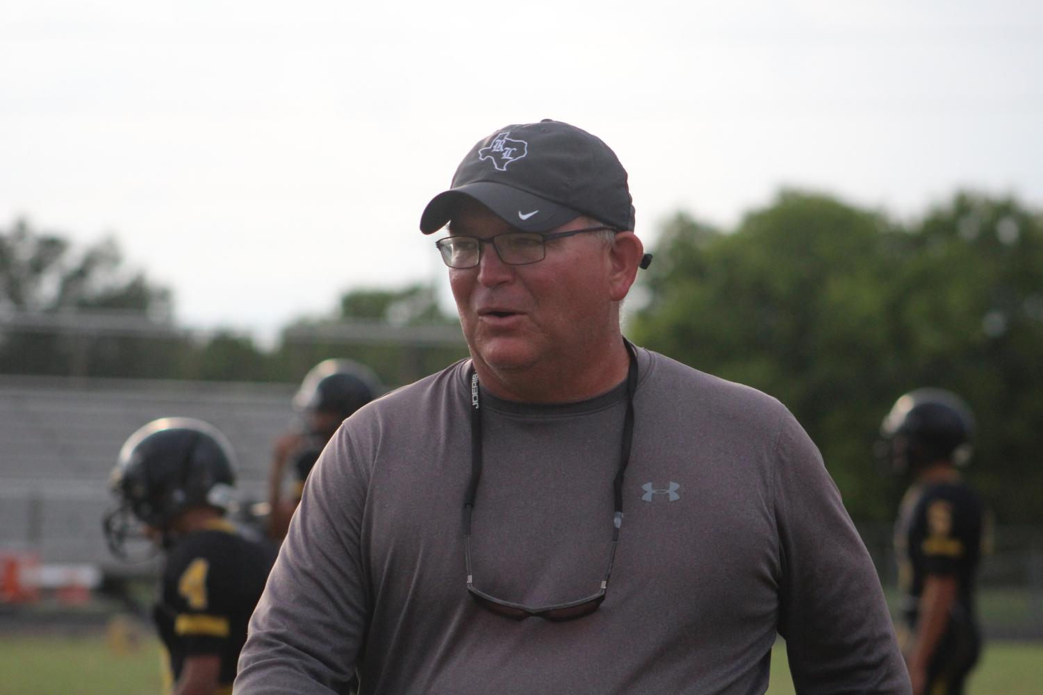 Coach Carter monitors during football practice. He is an assistant football coach and this year's new head girls basketball coach.