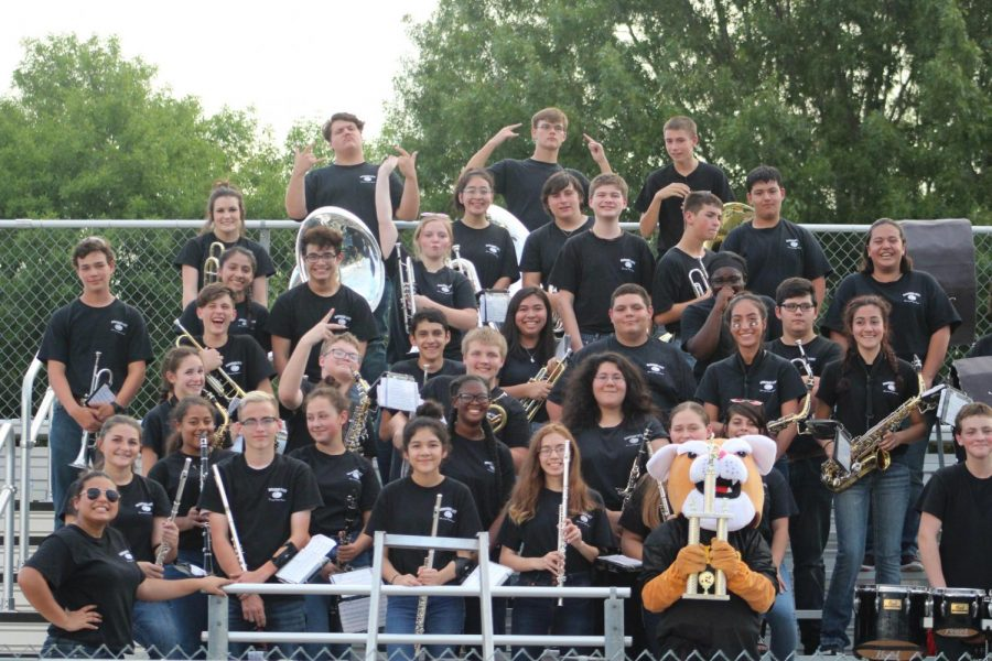 The+Cougar+Band+poses+with+the+trophy+from+KCEN+Battle+of+the+Bands+after+winning+against+Chilton+early+in+the+season.+