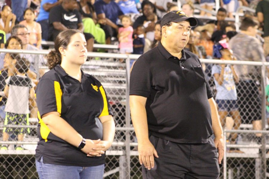 Directors David Veteto and Camber Comeaux watch the performance during a Friday night halftime.