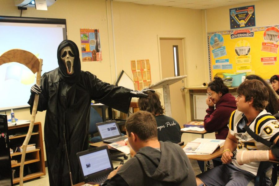 The+Grim+Reaper+taunts+students+in+Mr.+Thorne%27s+class.+