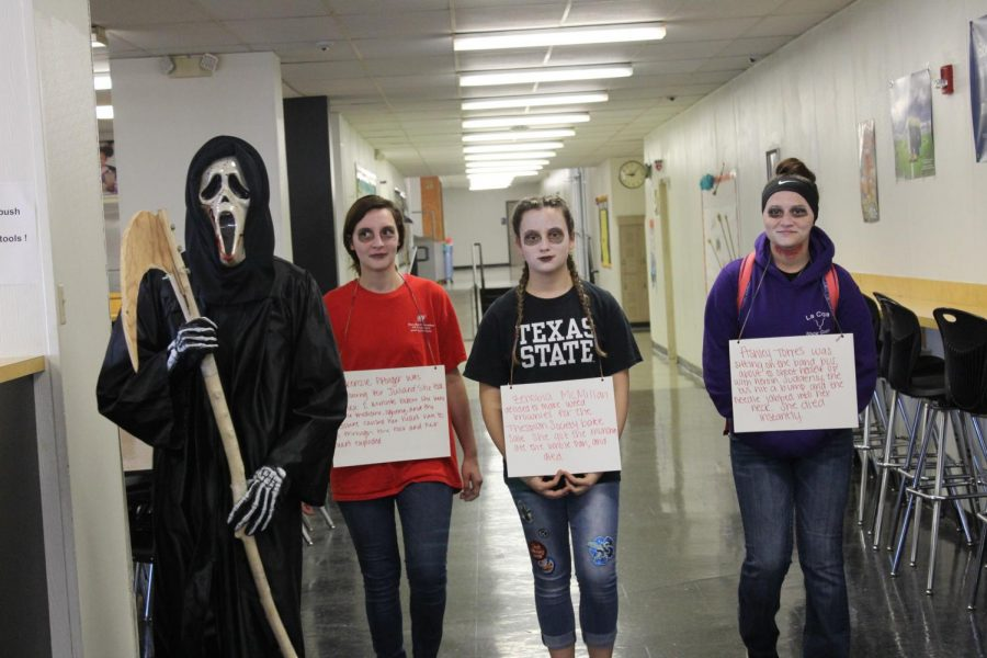 The Grim Reaper walks the hallways of the school with three of his most recent victims: Ashley Torres, Mackenzie Pfluger and Zenobia McMillan.