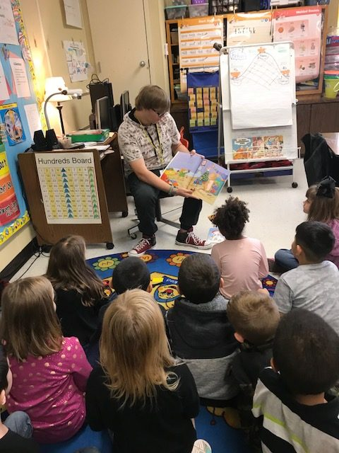 Austin Williams reads aloud to a kindergarten class during the Thespian Societys annula trip to Rosebud Primary to read to students.