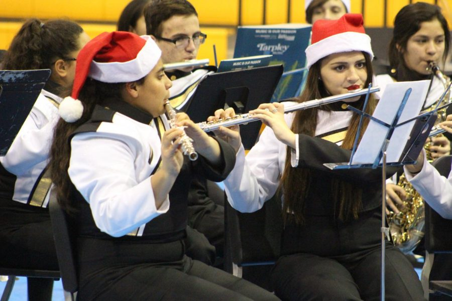Ashley+Torres+and+Kaitlyn+Alonso+play+during+the+Christmas+Concert.+