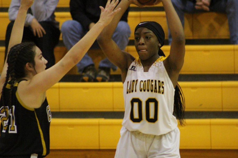 Rakasia Buhl looks for an open man during a district match-up with Crawford Friday night.