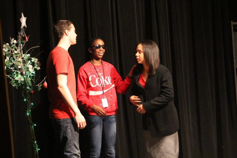 John Pappendorf, Hope Hardy and Emily Ventura perform a scene from their Christmas play.