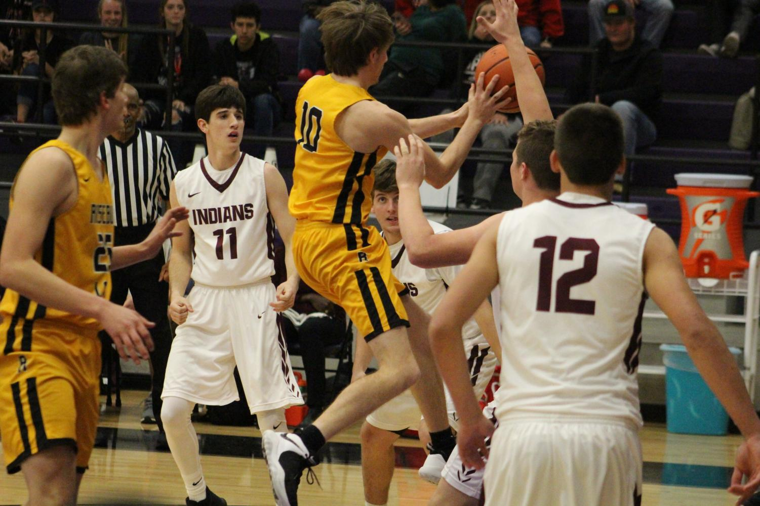 Haven Mortimer drives to the basket in the bi-dstrict win Monday night.