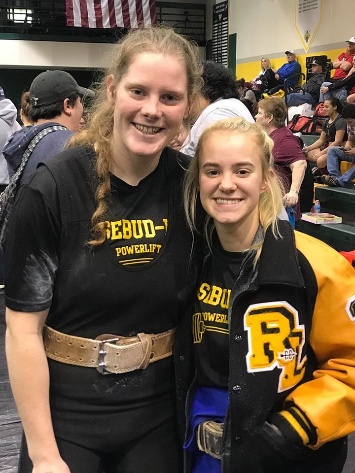 Clara Coker and Lily Dawson pose for a photo after competing in the Regional Powerlifting meet in Academy last weekend.