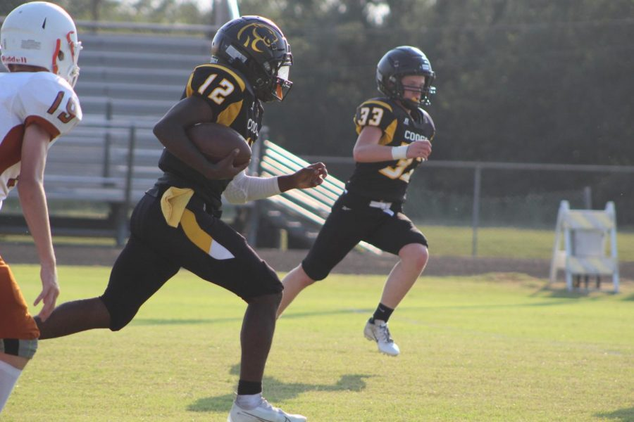 DeMarcus Hicks runs the ball down the field in the Cougars loss to Caldwell.
