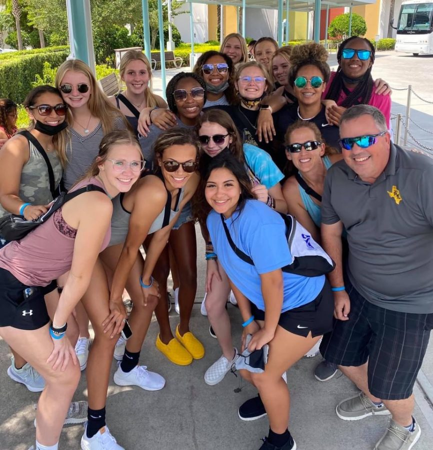 Volleyball team poses for a picture at Universal.
