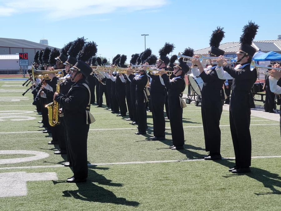 The band begins their field warm up.